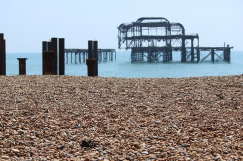The old pier looks mysterious on the horizon