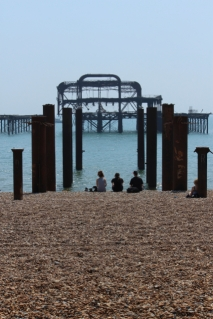 Three friends look through the avenue of ruins to the sea...