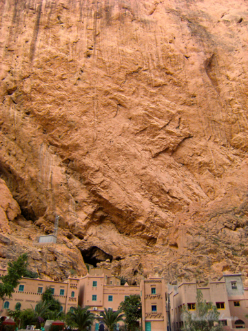 The Todra Gorge looms large over buildings made from its stone...