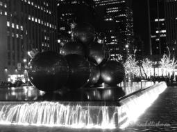 Giant Christmas ball-balls decorate a fountain near the Rockefeller Centre