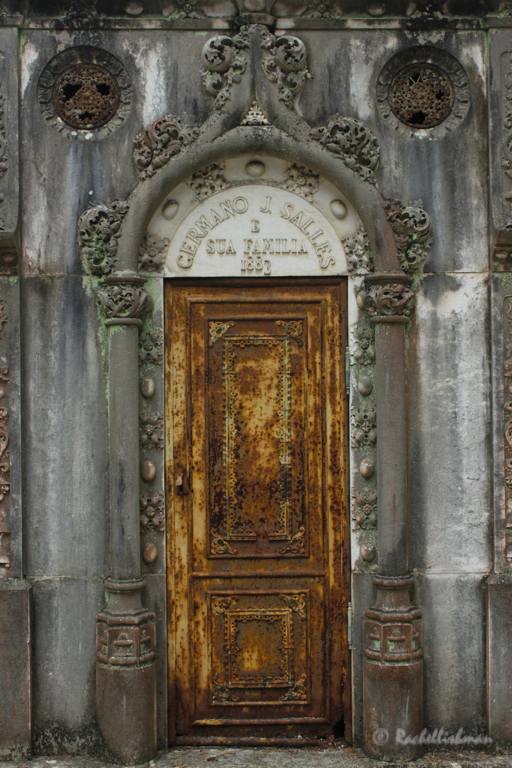 A decaying doorway leads to a family's final home
