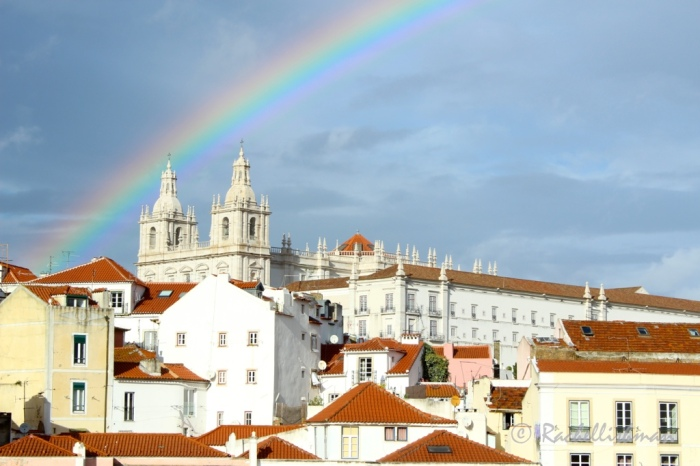 Proof that the sun doesn't always shine! Storm clouds recede behind a stunning rainbow at one of Alfama's look-outs.