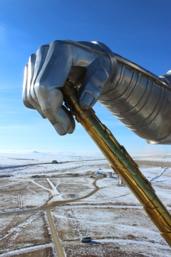 The gigantic hand of Genghis Khan takes hold of the wintery landscape