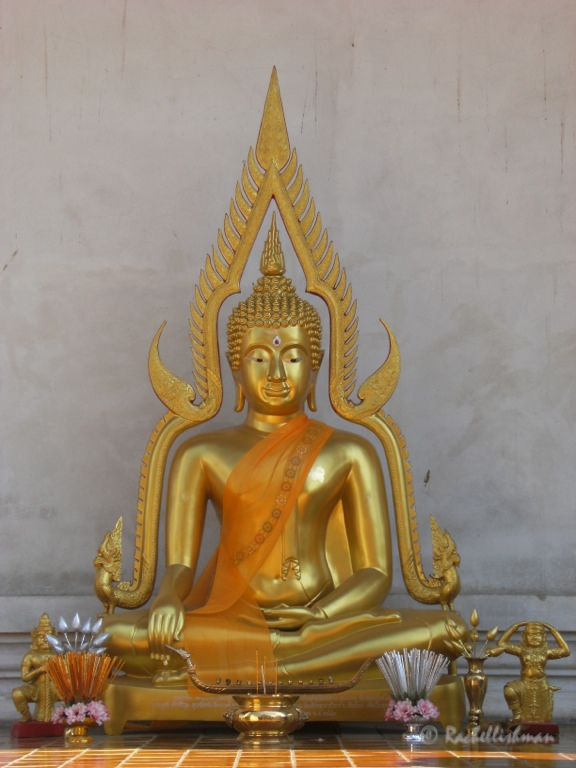 A Buddha sits quietly in Wat Chedi Luang Temple in Chiang Mai
