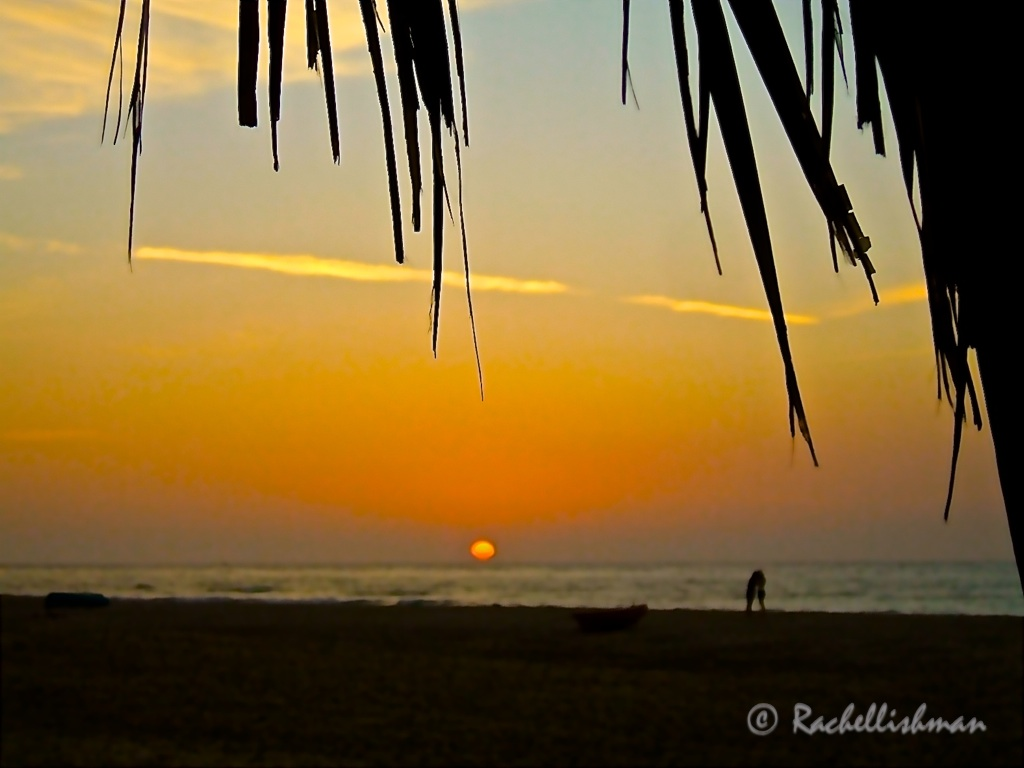 A moment in time: As I watched the sun set over the Pacific in Peru, a couple shared a hug on the shore.