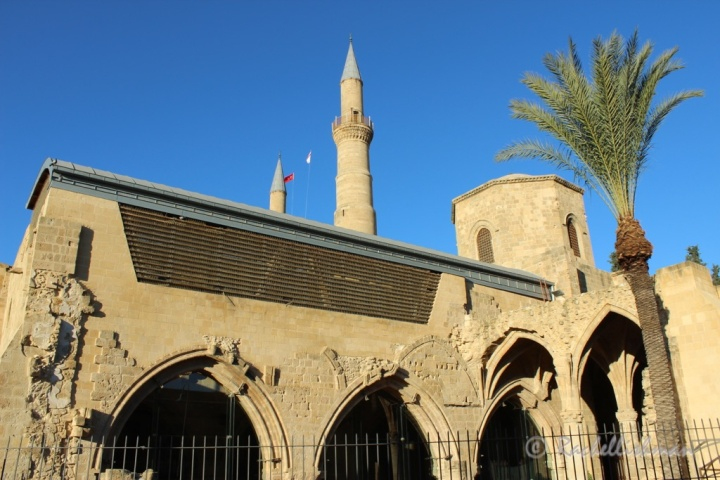 Lefkosia's mosque rises up behind a neighbouring church.