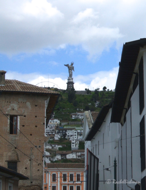 El Panecillo hill stands above the city...