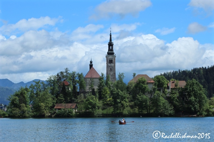 The post-card view that I couldn't resist. Tourists take a row boat over to Lake Bled's famous island church