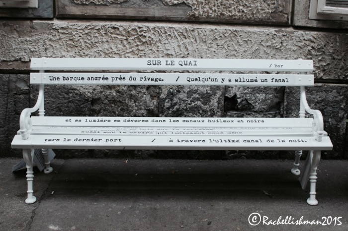 Multi-lingual poetry benches line this small street in the city centre!