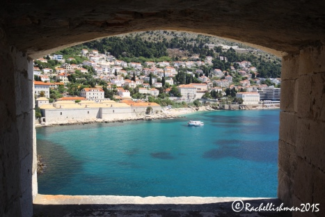Through the wall, this window frames Dubrovnik's best stretch of city beach
