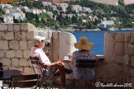 A couple take a break from their wall walking at a strategically placed cafe