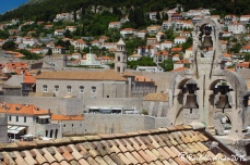 Churches' bell towers punctuate the red roofs of other buildings when viewed from above