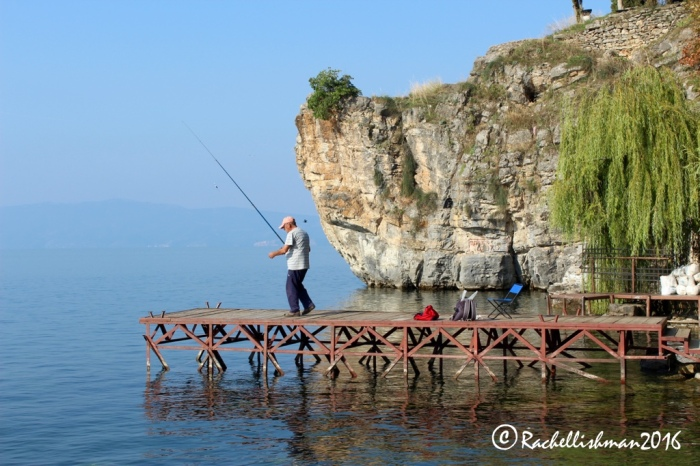 After getting their daily catch, fisherman sip morning coffees alongside Ohrid's growing tourist population