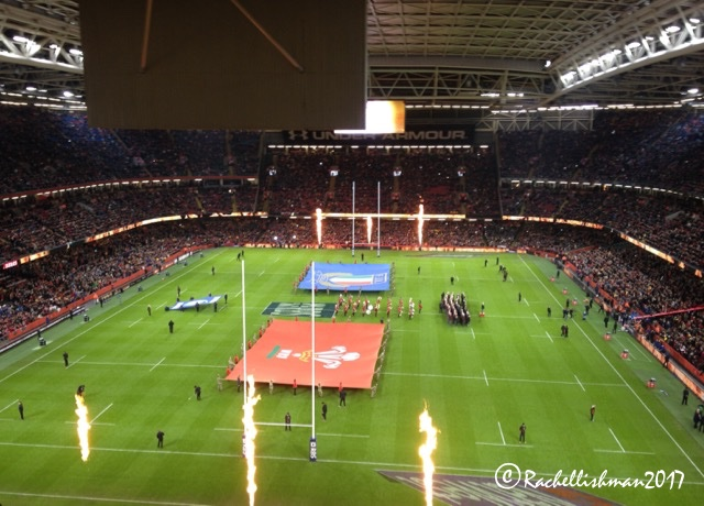 Wales vs. Italy at the famous covered stadium; complete with mass sing-songs and even flames!