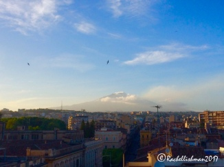Mount Etna looming behind Catania's roofs on a beautiful early summer's evening