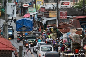 Rio Dulce's main road is a national highway but that doesn't discourage pedestrians and stall owners.