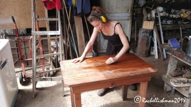 Sanding furniture in the taller