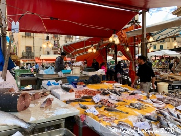 Fish of the day is served up in historic Ballaro market.